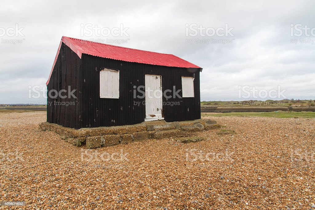 Black wooden shed, once used as Master TARDIS. stock photo