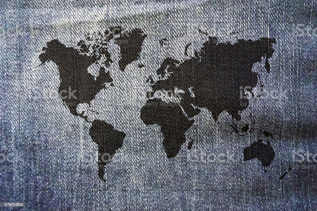 Black world map on jeans stock photo