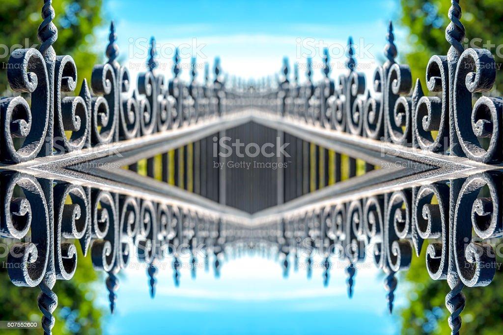 Black wrought iron luxury fence symmetric shaped kaleidoscope stock photo