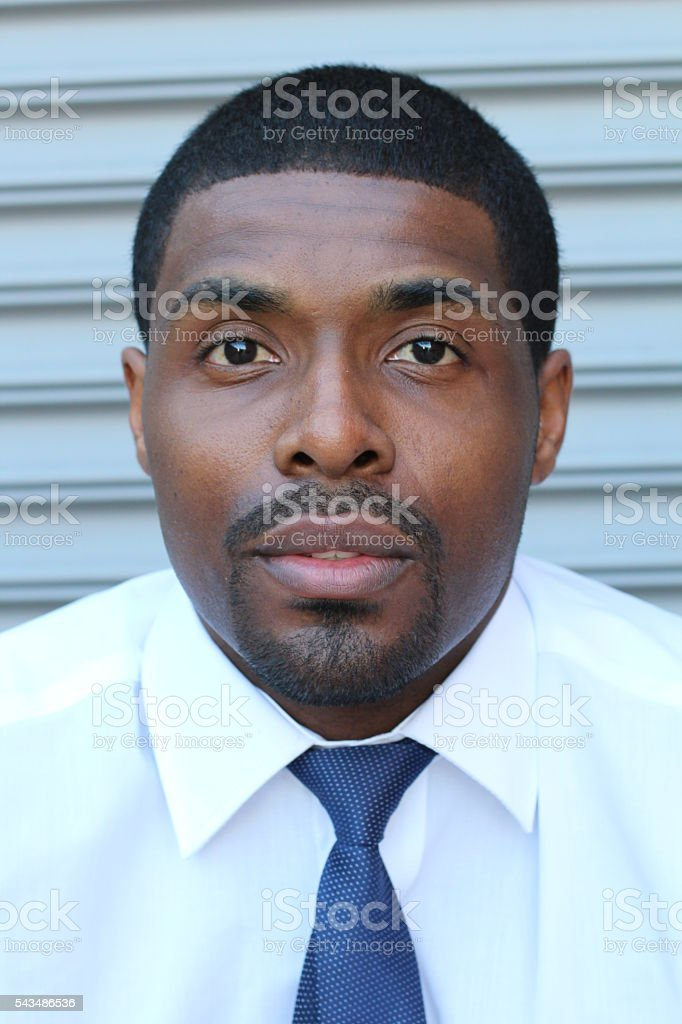 Black young African businessman looking serious stock photo
