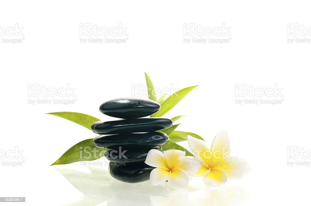 Black zen stone with two white flowers royalty-free stock photo