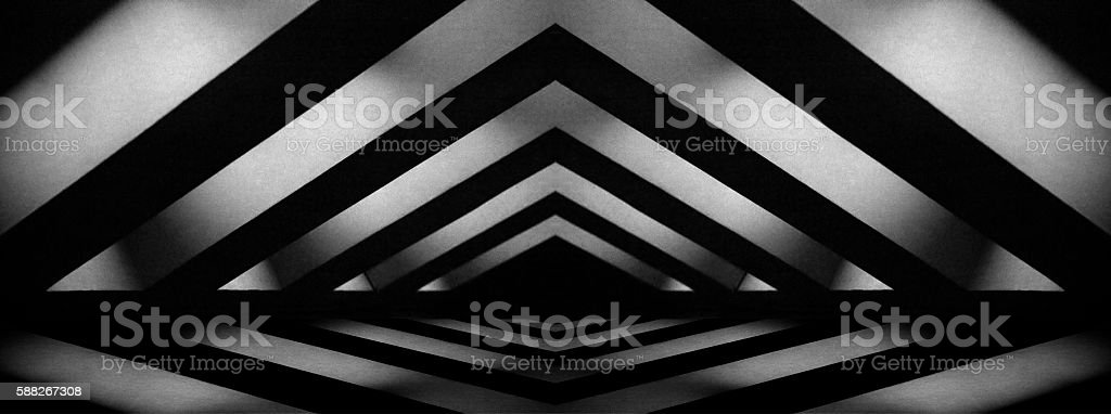 Black-and-white photo of mansard or attic with light from windows stock photo