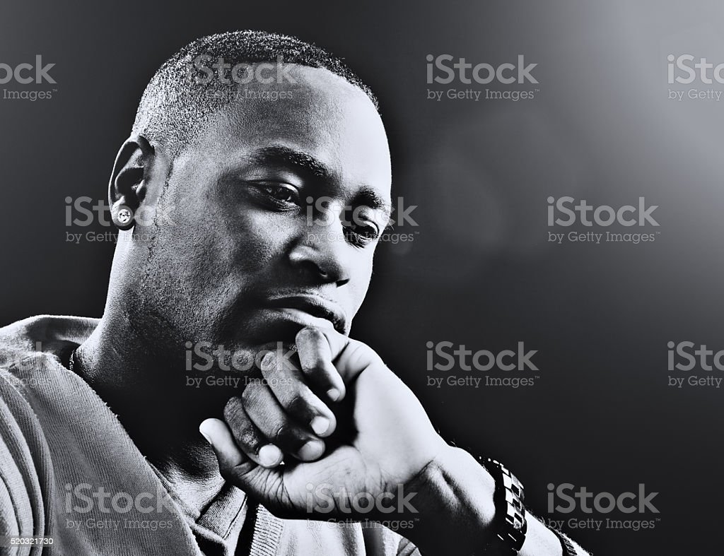 Black--and--white portrait of serious man, deep in thought stock photo