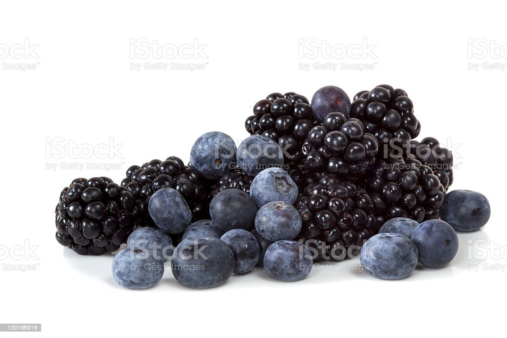 Blackberries and blueberries on white background stock photo