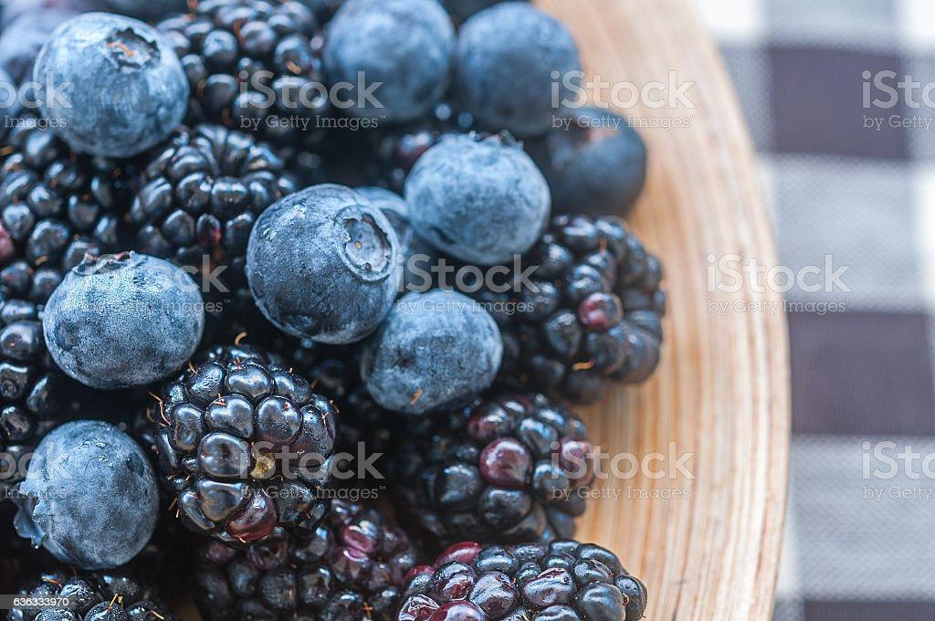 Blackberries and blueberries stock photo
