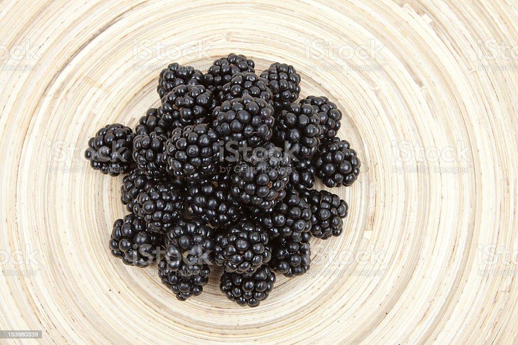 blackberries heap on a wooden board stock photo