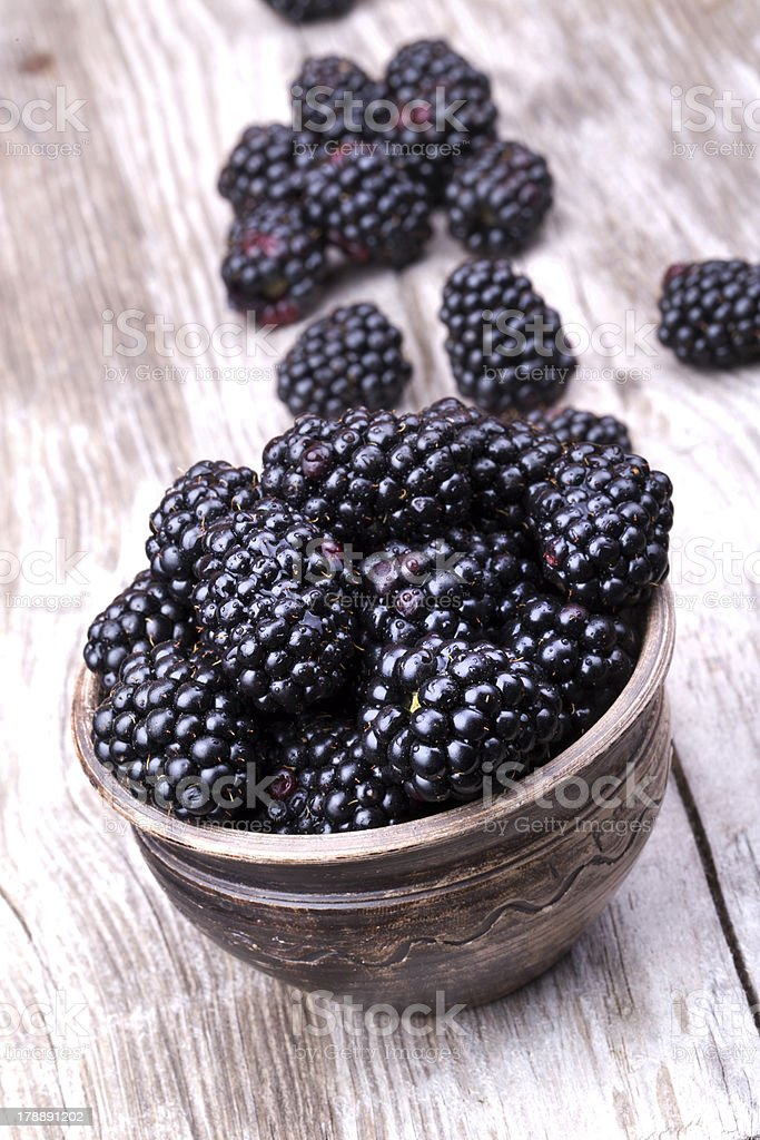 blackberries on wooden table royalty-free stock photo
