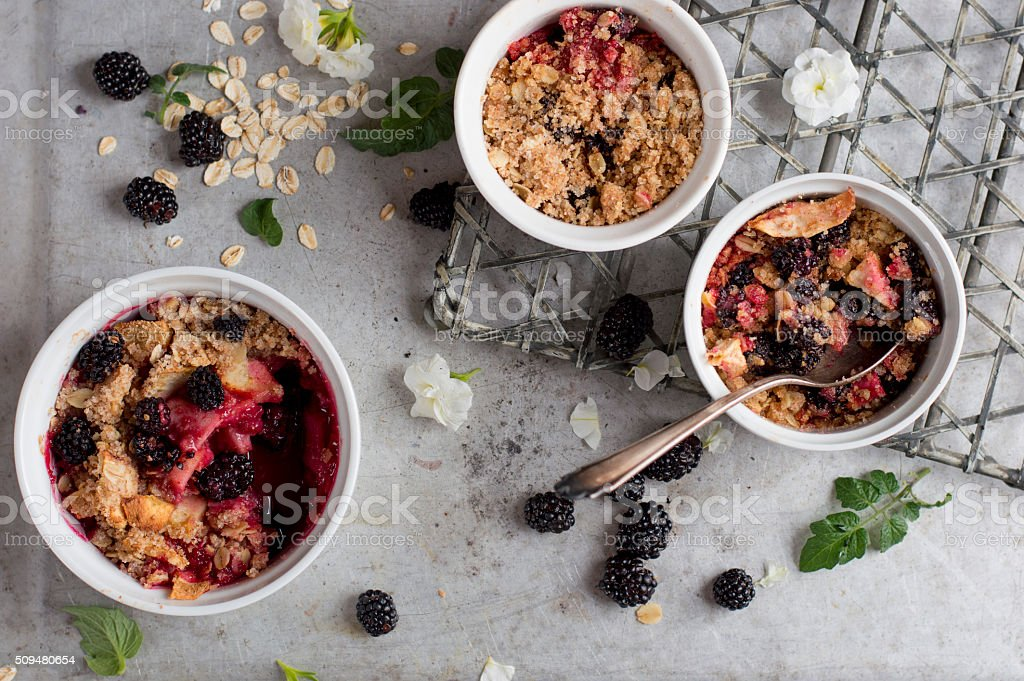 Blackberry and apple crumble dessert stock photo