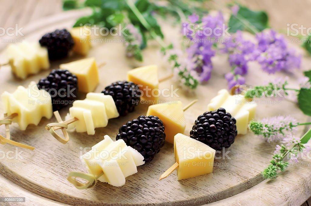 Blackberry and cheese sticks stock photo