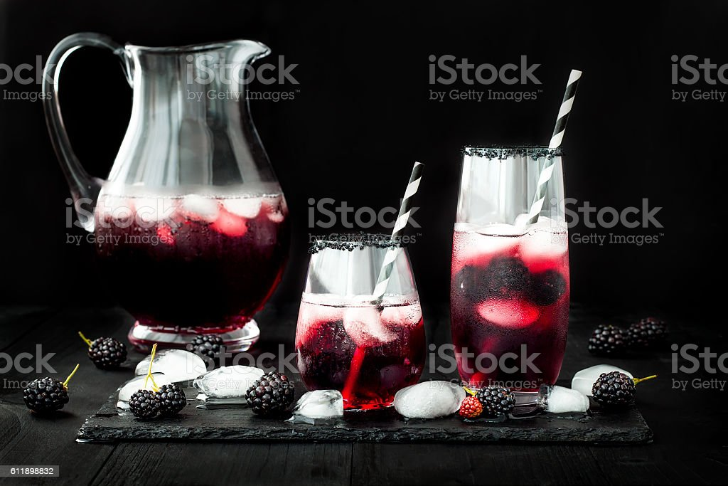 Blackberry drink in glasses for fall and halloween parties stock photo