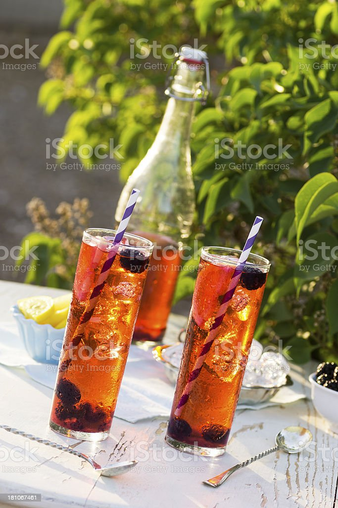 Blackberry Iced Tea in the Garden stock photo