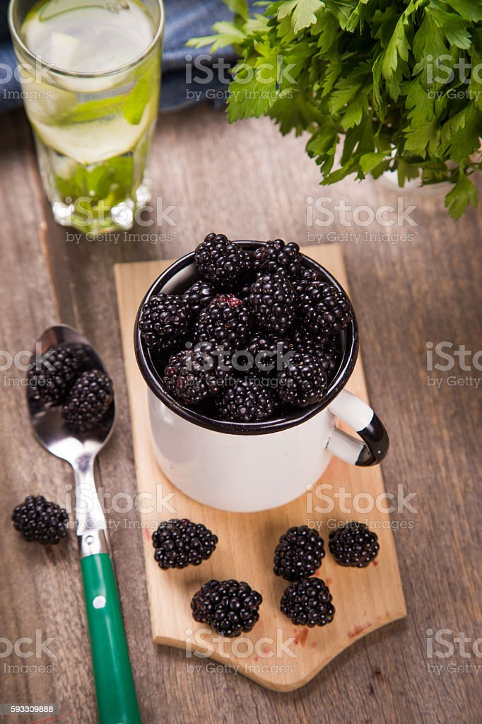 blackberry in old cup stock photo