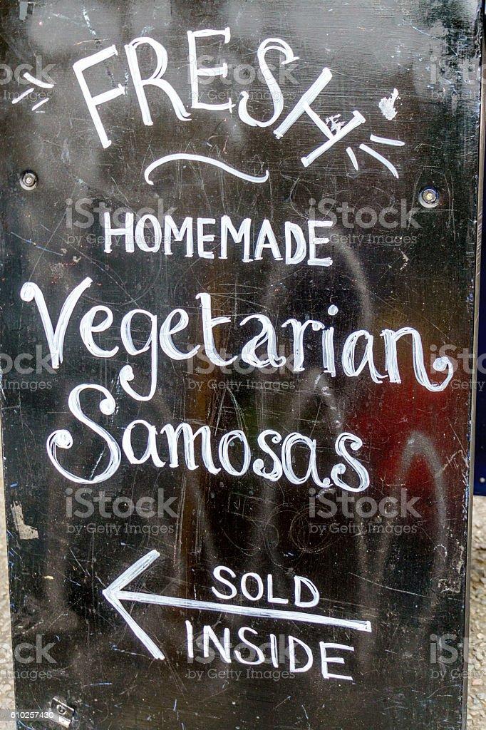 Blackboard advertising fresh samosas stock photo