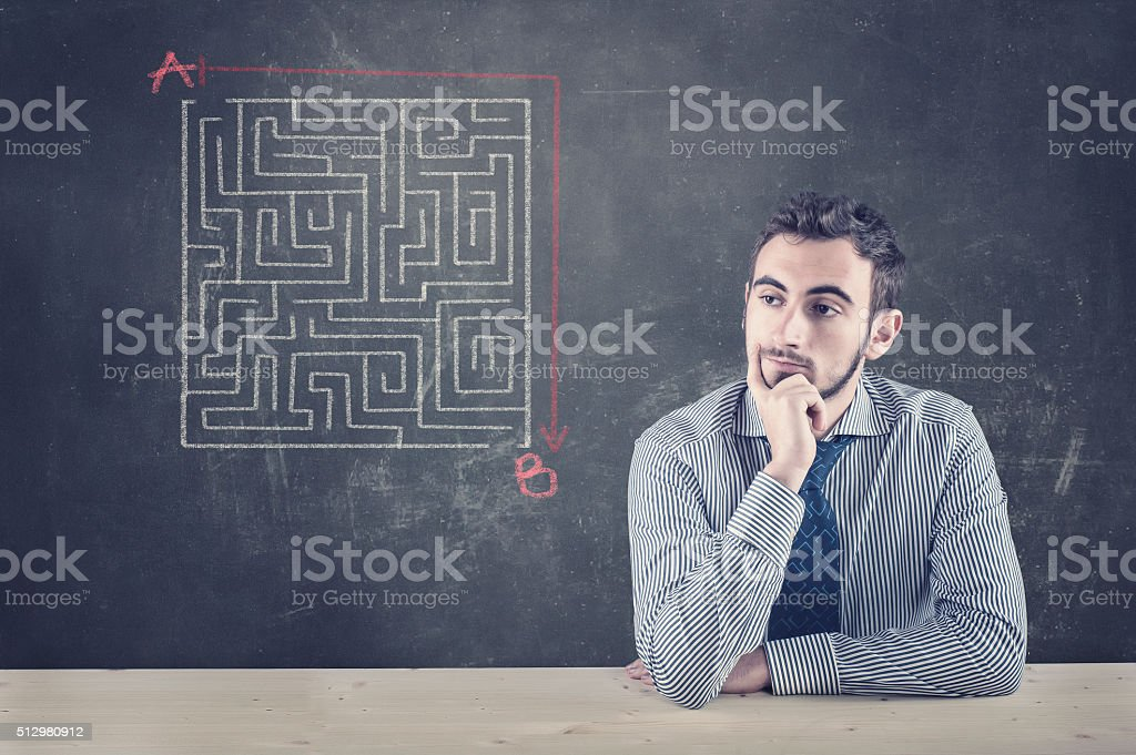 Blackboard and a maze stock photo