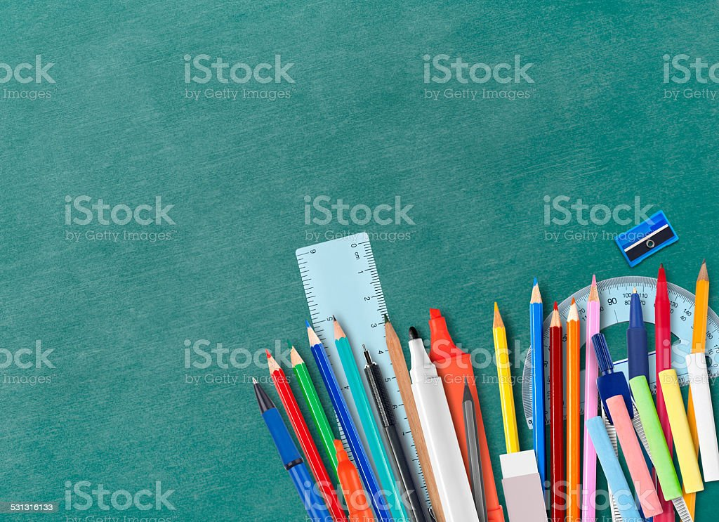 Blackboard and school supplies stock photo