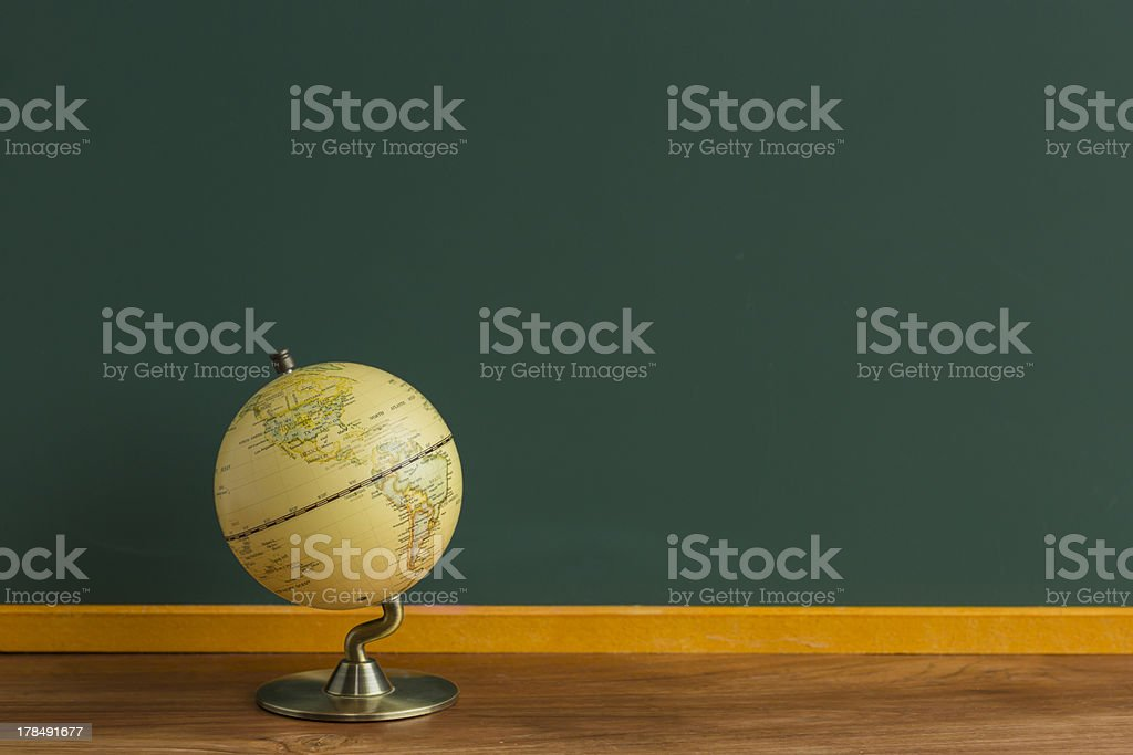 Blackboard and terrestrial globe stock photo
