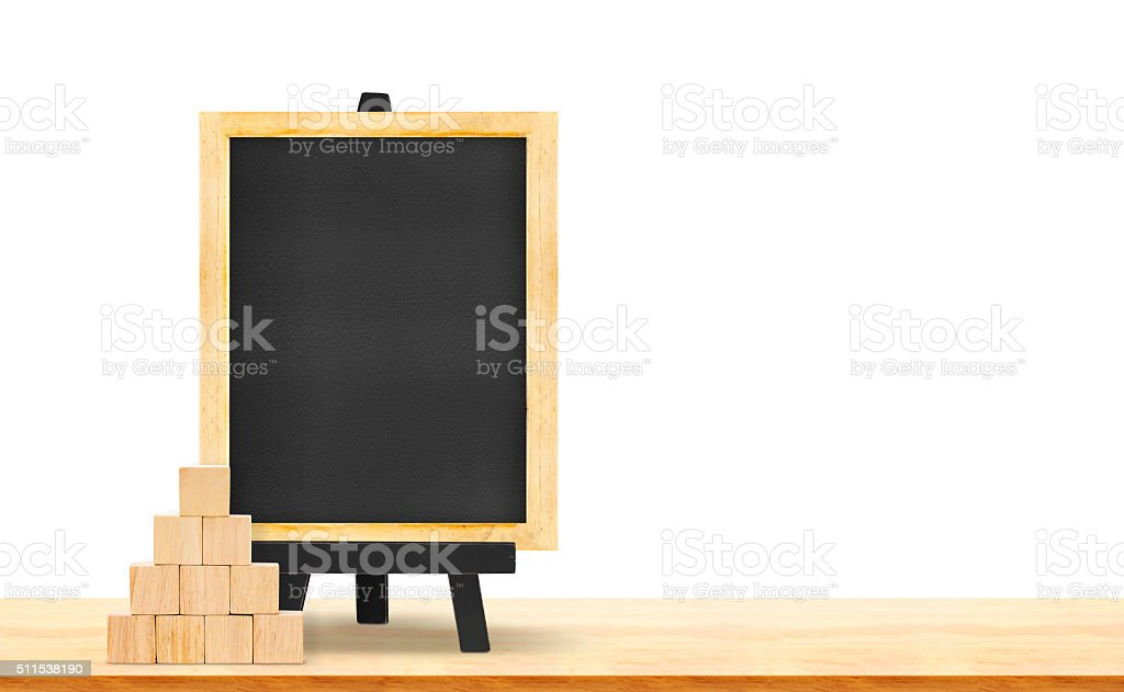Blackboard and wood cube on wood table isolated on white stock photo