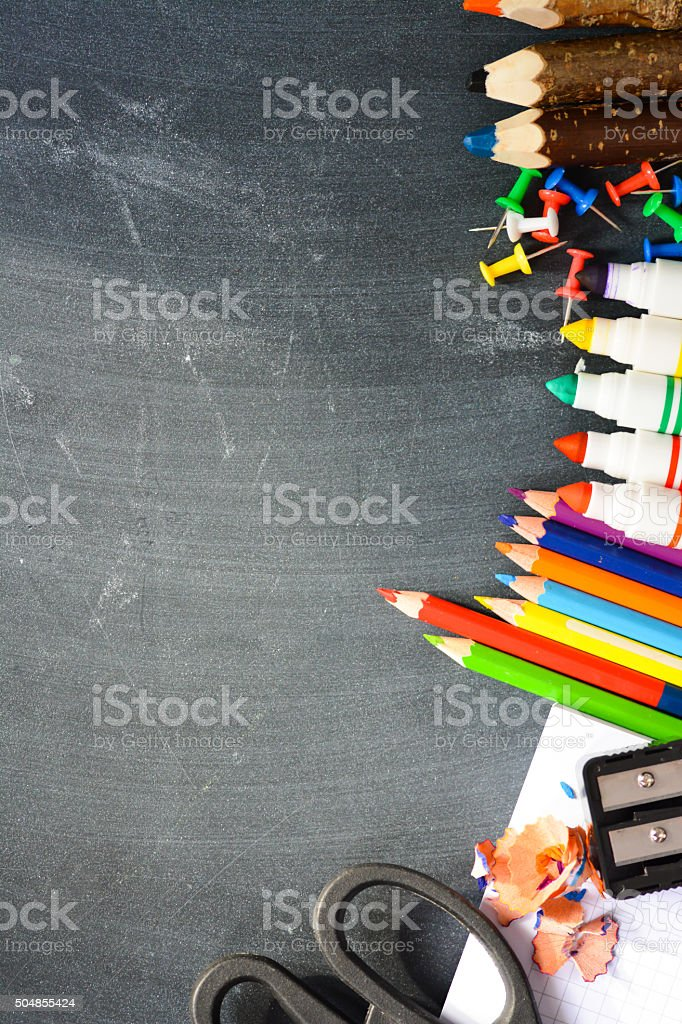 Blackboard background with school supplies suggesting back to school season stock photo