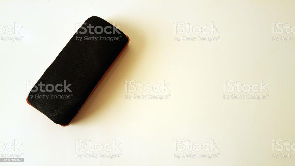 Closeup of a blackboard eraser on a whiteboard