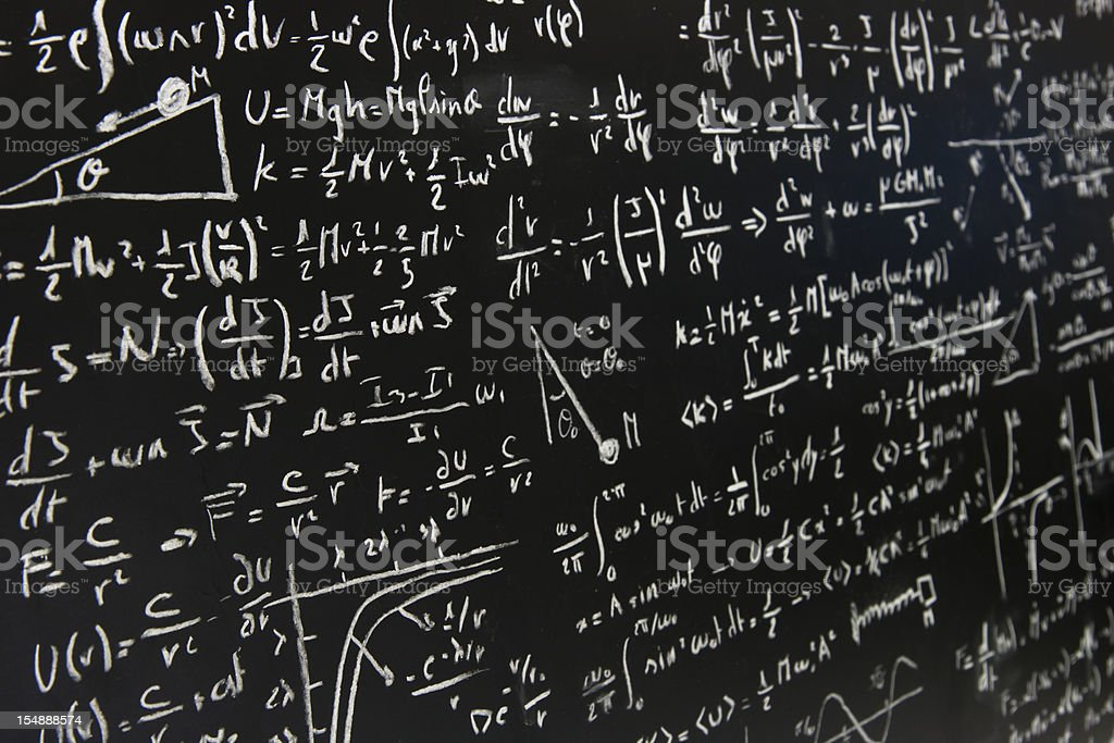 blackboard full of equations stock photo