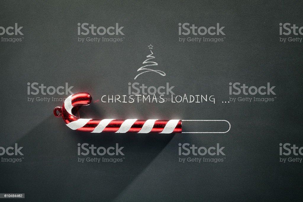 Blackboard Holiday Decoration - Christmas loading Candy Cane stock photo