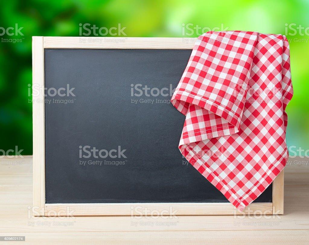 Blackboard menu recipe frame picnic cloth background. stock photo