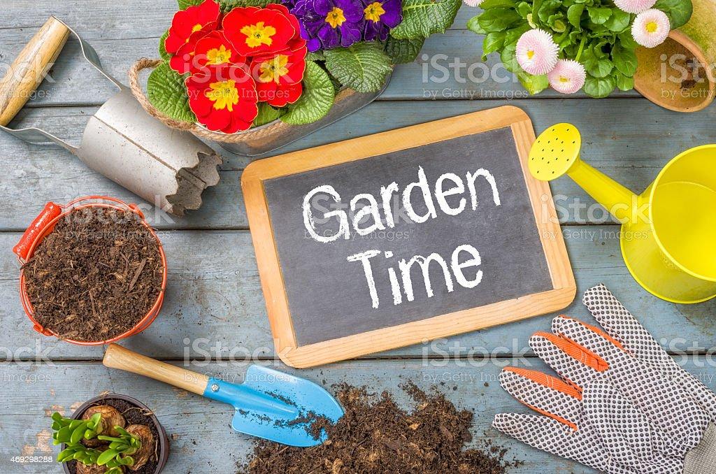 Blackboard on a plant table  - Garden Time stock photo