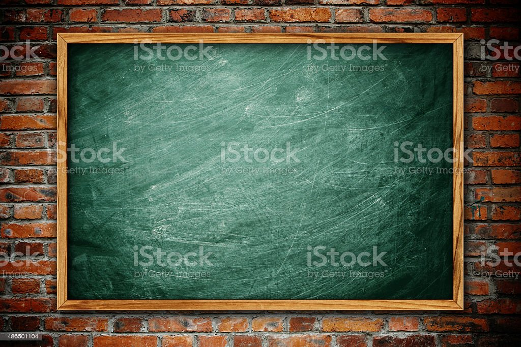 Blackboard on the brick wall background stock photo