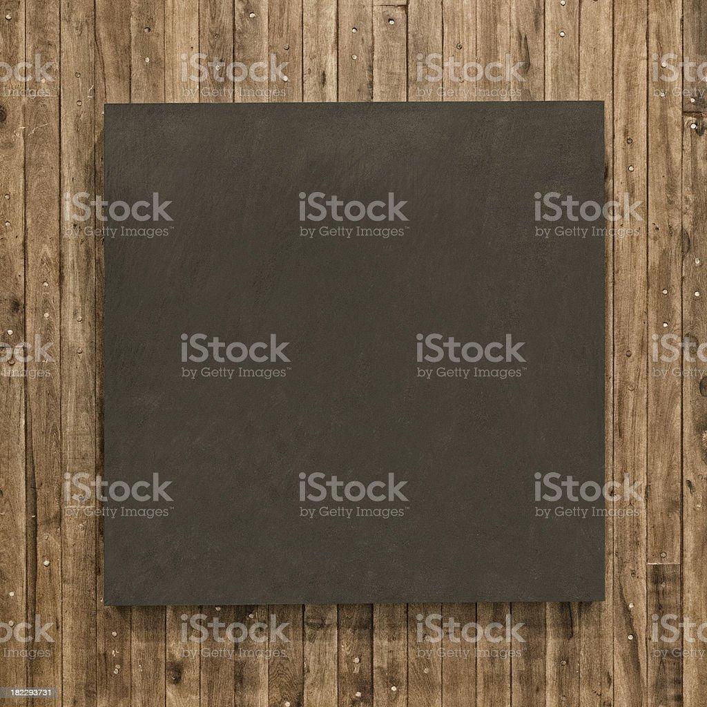Blackboard on wood wall royalty-free stock photo