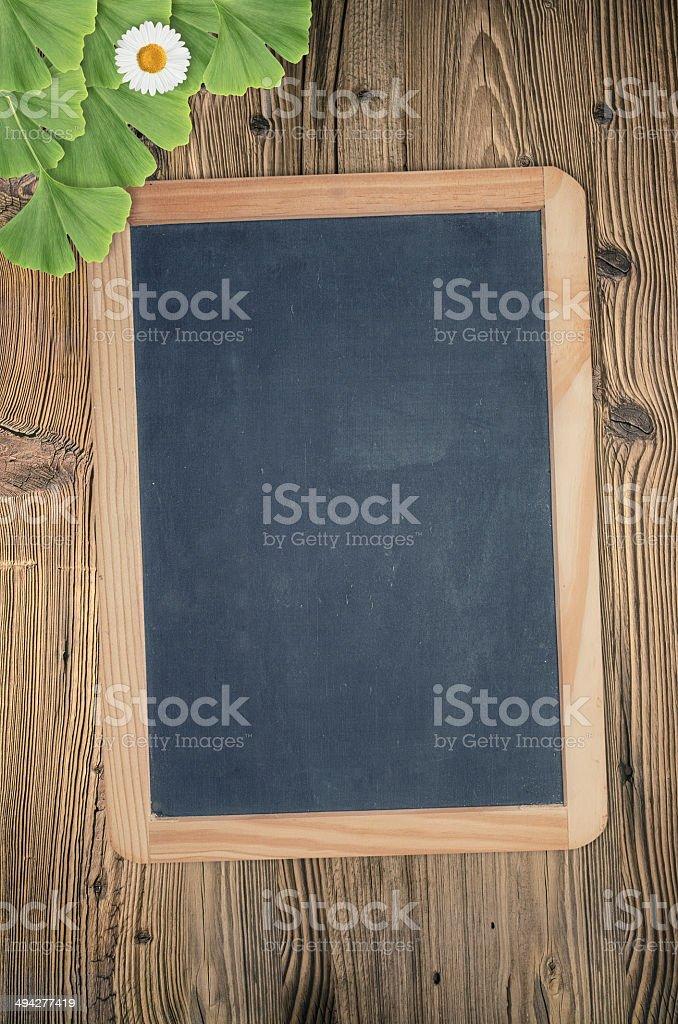blackboard on wooden background stock photo