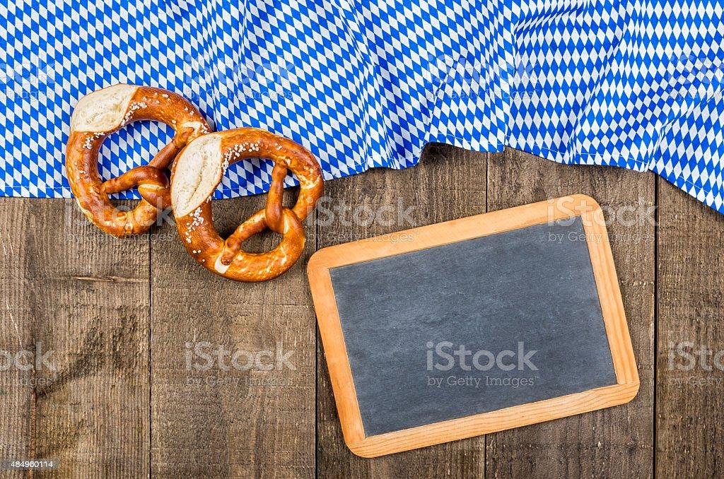 Blackboard with a bavarian diamond pattern and pretzels stock photo