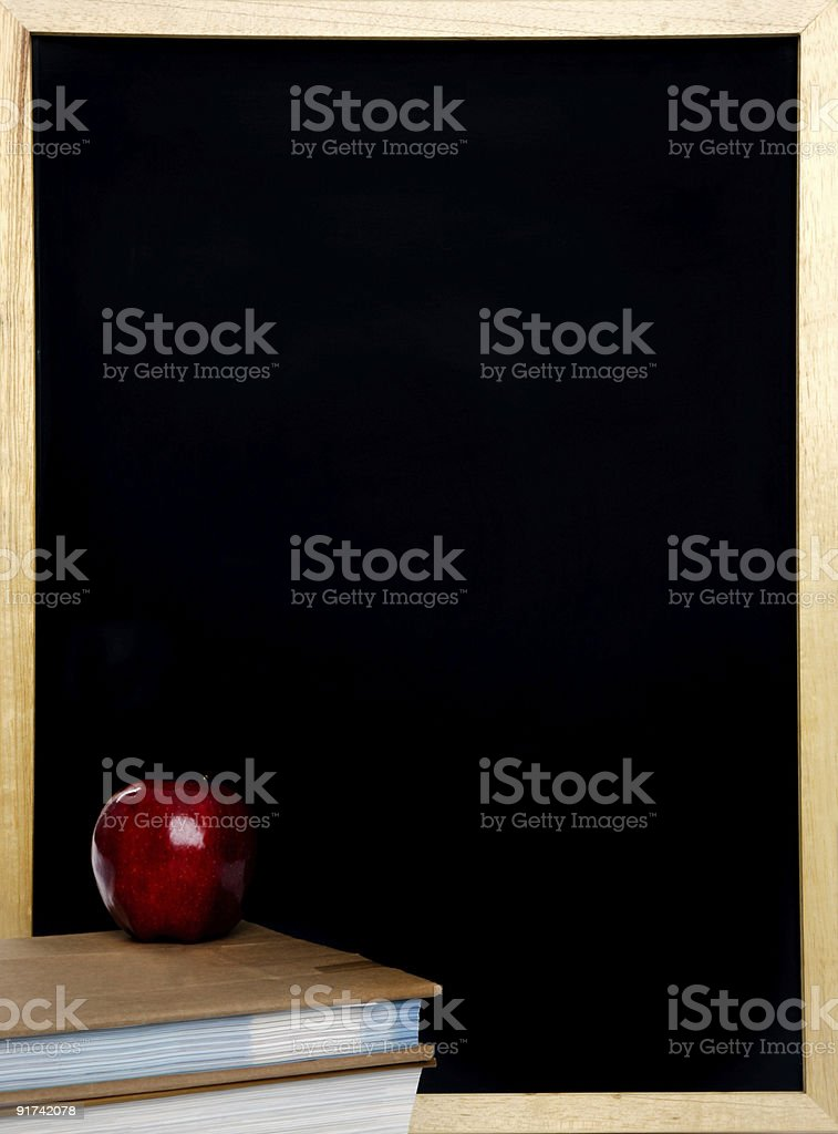 Blackboard with apple and books royalty-free stock photo