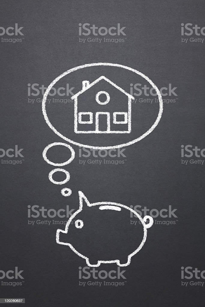 blackboard with chalk drawing of a piggy bank thinking house stock photo