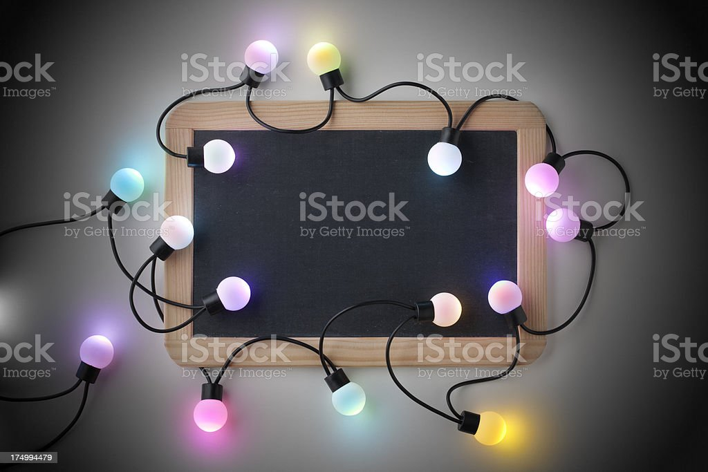 Blackboard with Christmas lights royalty-free stock photo