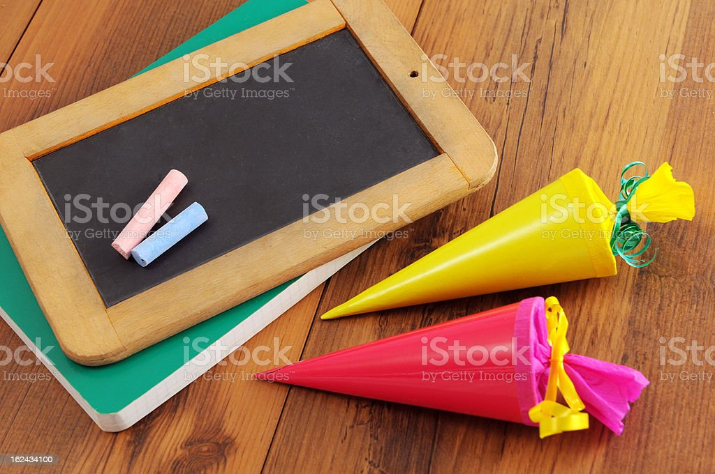blackboard with copyspace forl words and Conical bag sweets stock photo