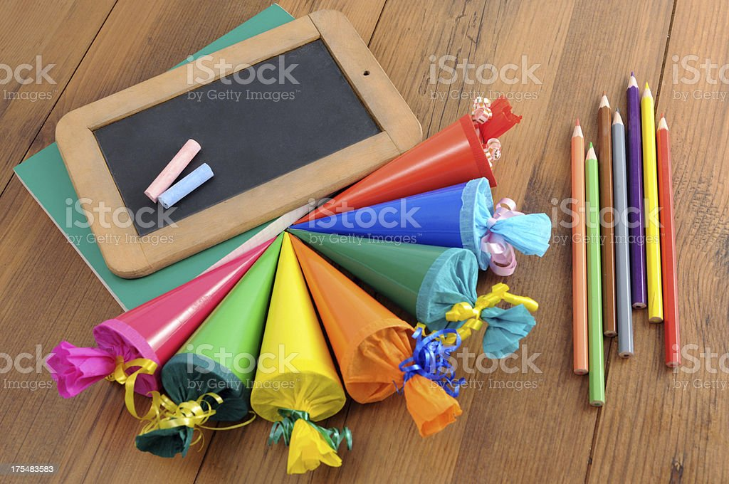 blackboard with copyspace on school work books and crayons. stock photo