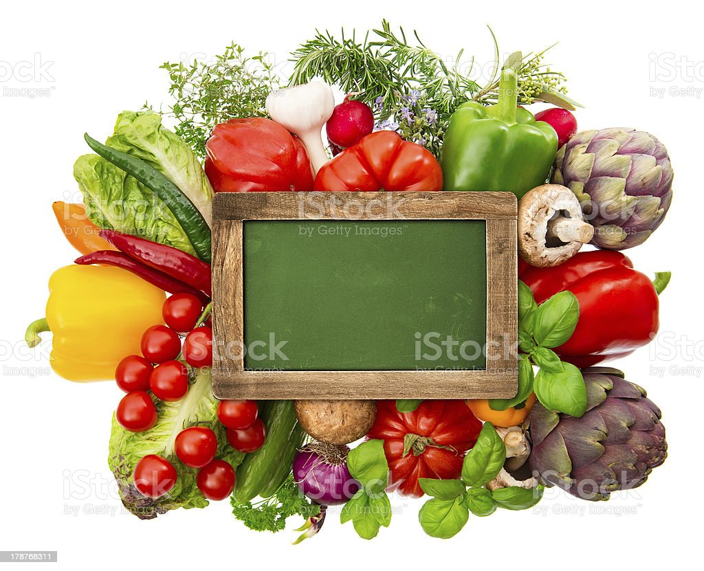 blackboard with fresh organic vegetables and herbs royalty-free stock photo