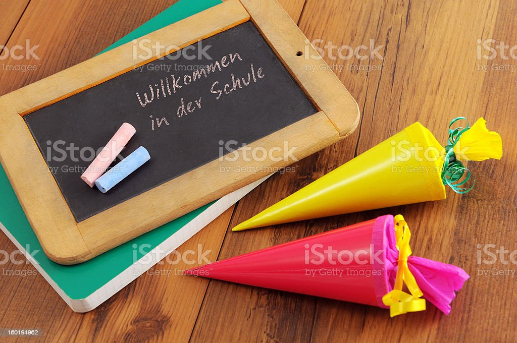 blackboard with German welcome to school words and Conical bag stock photo
