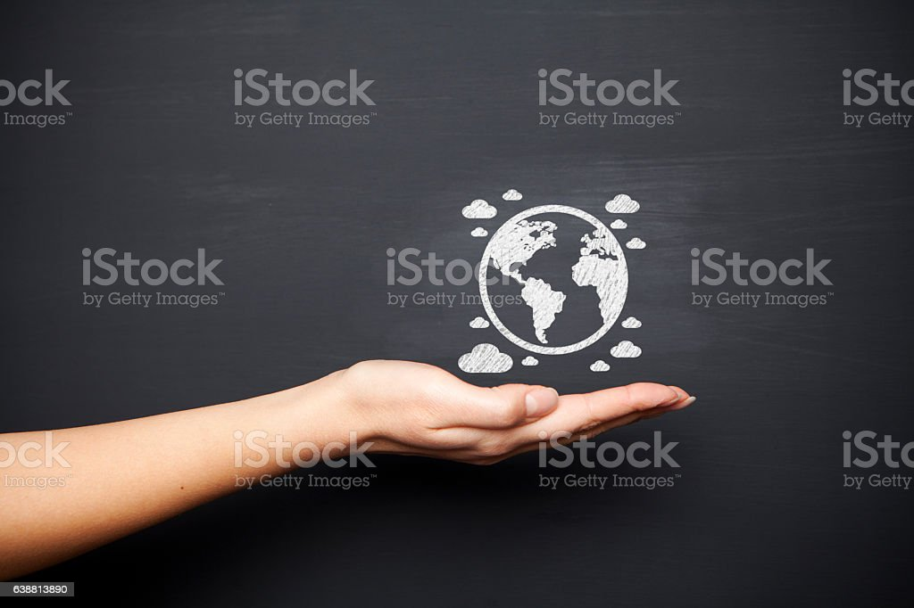 Blackboard with hand and globe stock photo