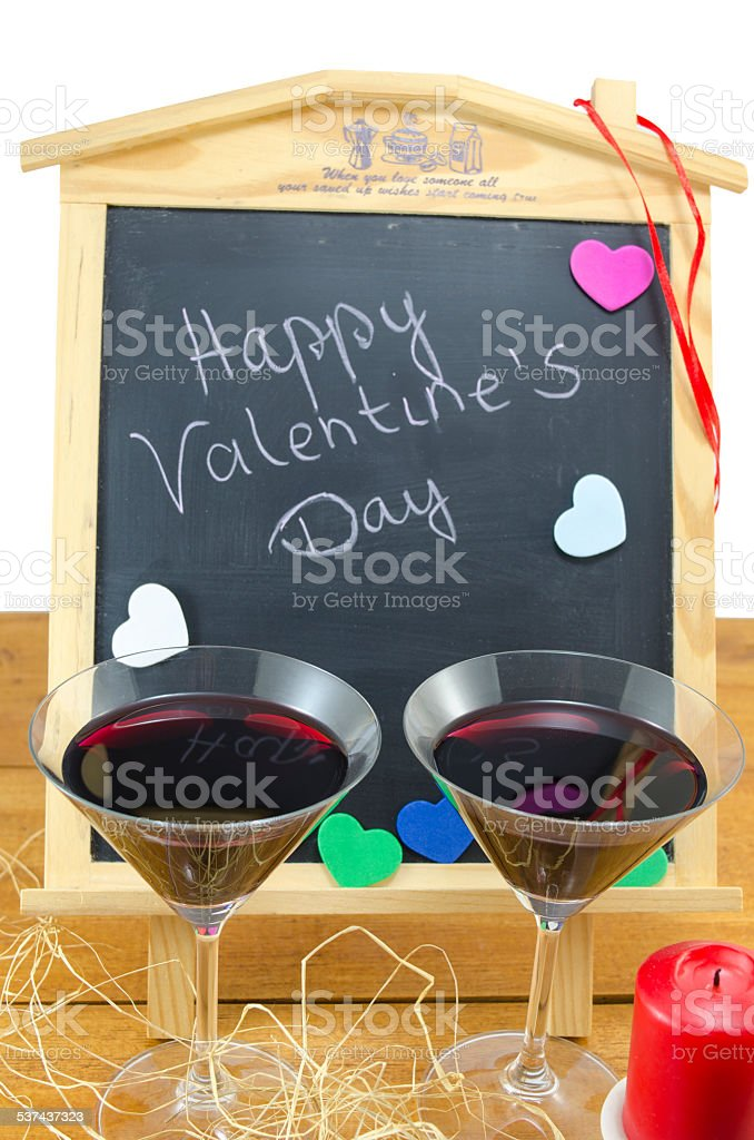 Blackboard with hearts and and two glasses royalty-free stock photo