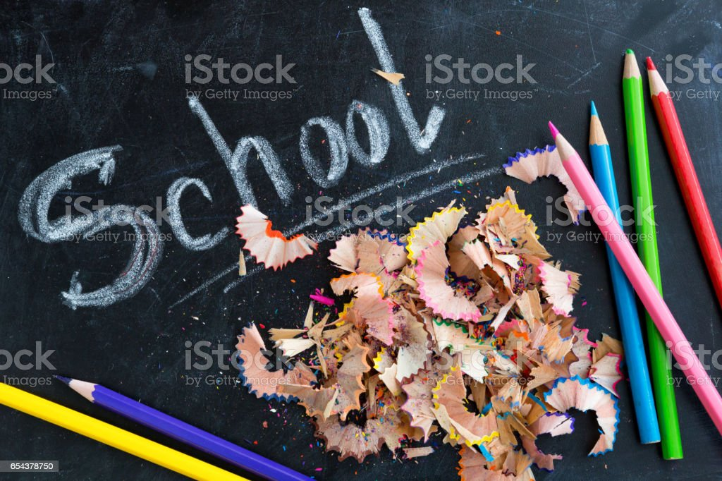 Blackboard with pencils and chips stock photo