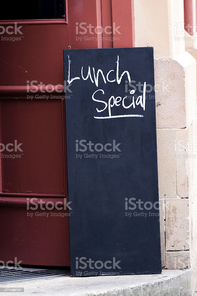 Blackboard with sign 'Lunch special' front of restaurant, copy space royalty-free stock photo