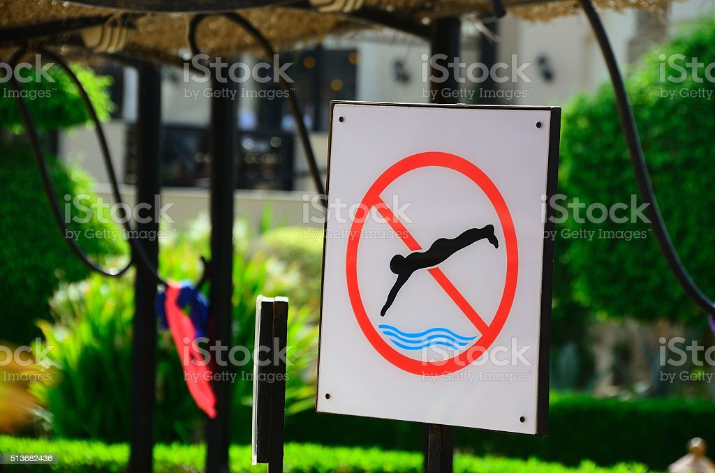blackboard with swimming forbidden stock photo
