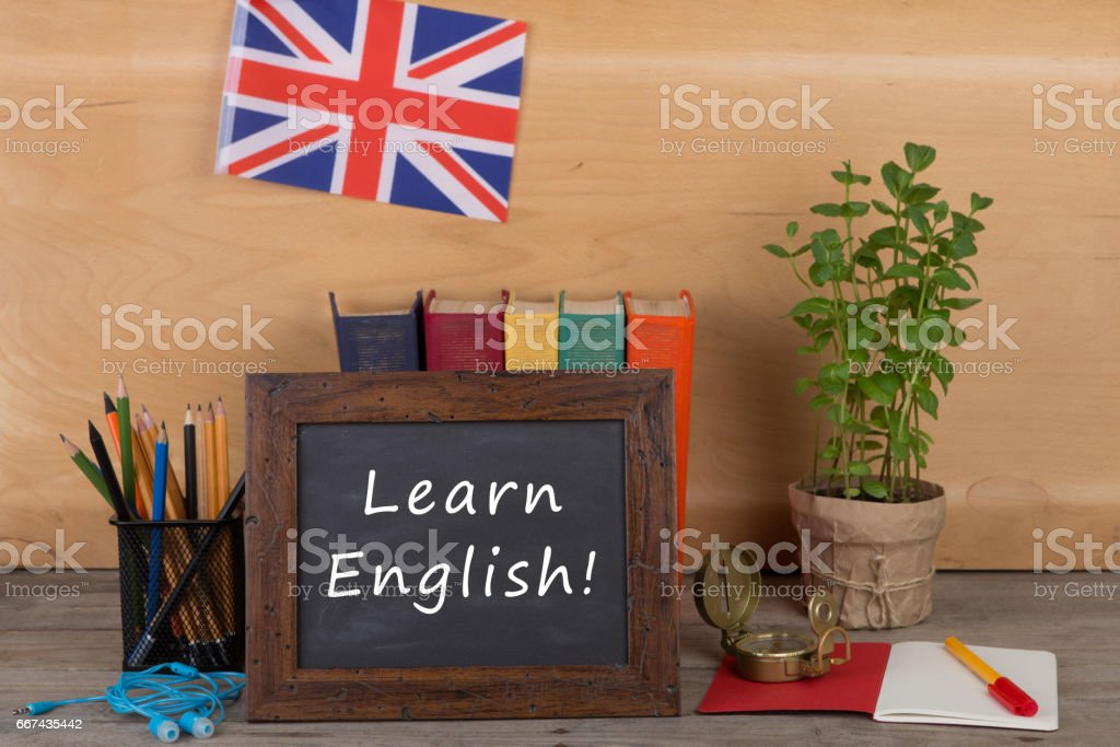 blackboard with text 'Learn English!', flag of the United Kingdom stock photo