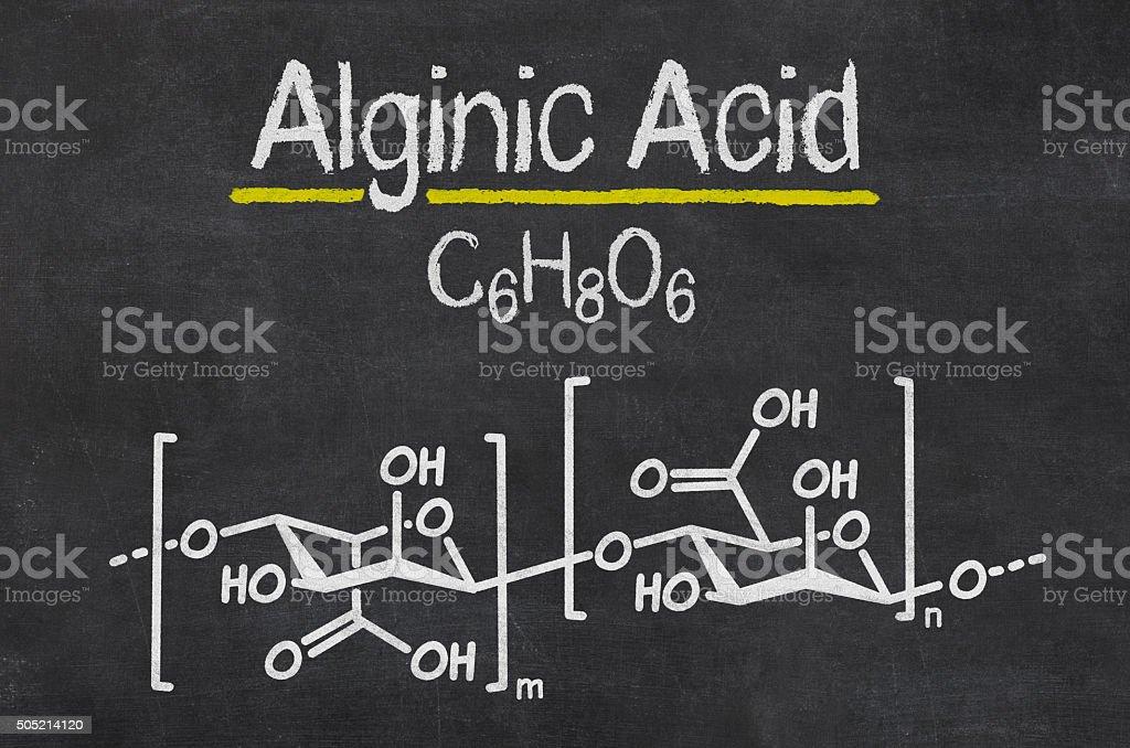Blackboard with the chemical formula of Alginic Acid stock photo