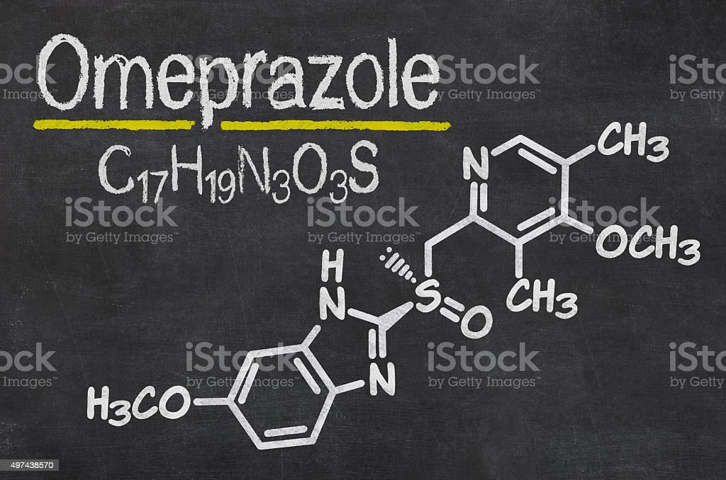 Blackboard with the chemical formula of Omeprazole stock photo