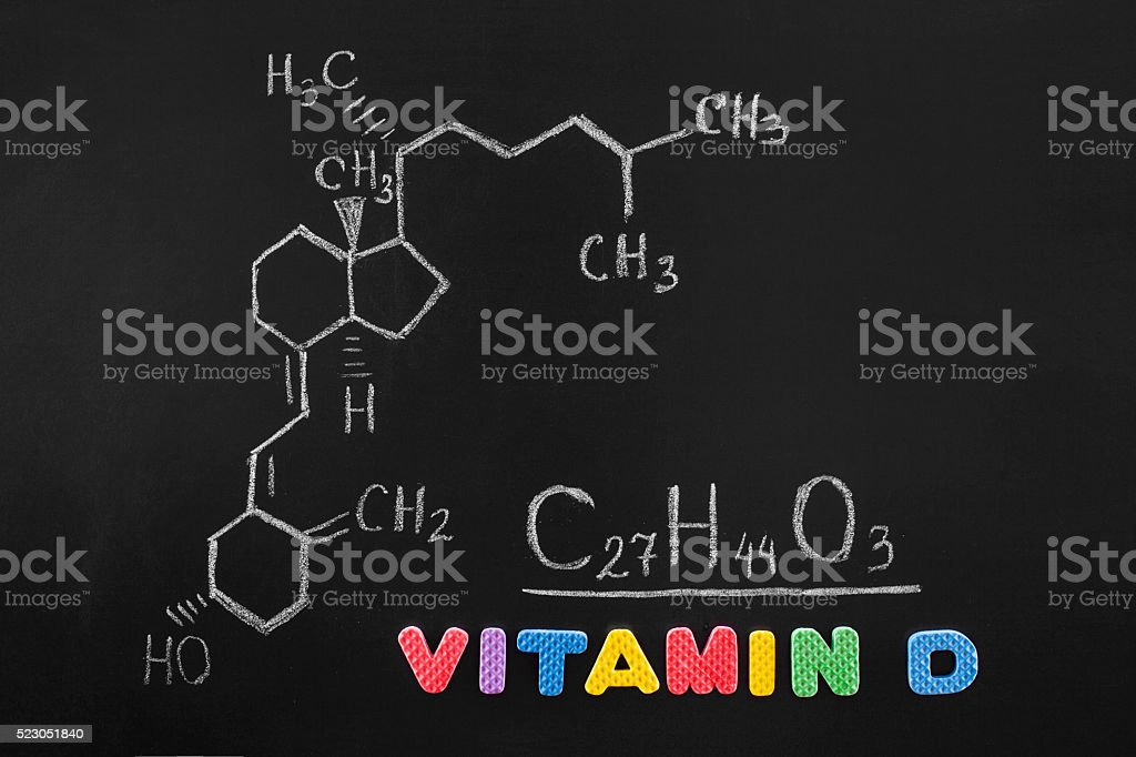 Blackboard with the chemical formula of Vitamin D stock photo
