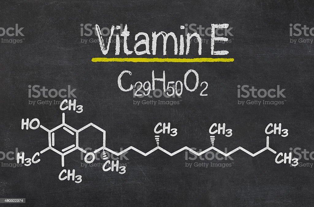 Blackboard with the chemical formula of Vitamin E stock photo