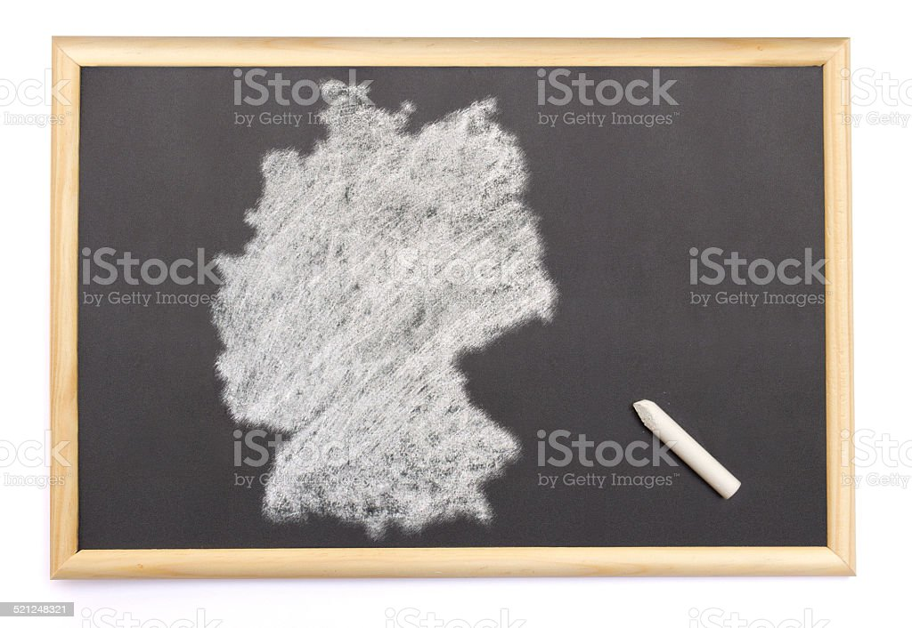 Blackboard with the shape of Germany drawn onto. stock photo