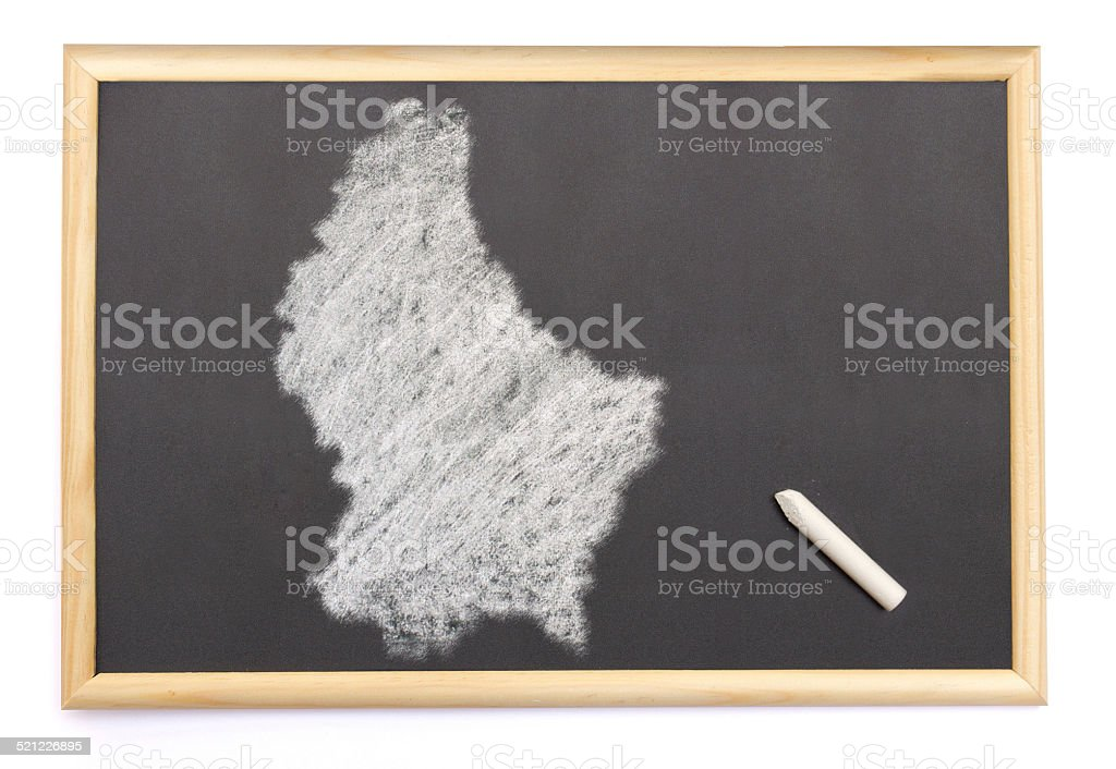Blackboard with the shape of Luxembourg drawn onto. stock photo